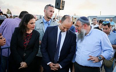 Education Minister Naftali Bennett and Justice Minister Ayelet Shaked at a rally to support residents, ahead of the expected evacuation and demolition of the illegal Jewish neighborhood of Netiv Ha'avot in the Etzion,  bloc on June 11, 2018. (Gershon Elinson/Flash90)