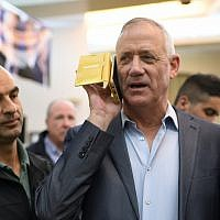 Benny Gantz, Head of Blue and White party speaks on a phone during an elections campaign event in Petah Tikva on March 13, 2019. (Gili Yaari/Flash90)