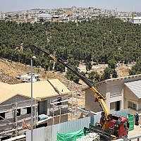 Illustrative: Construction work in the Dagan neighborhood of the settlement of Efrat, in the West Bank on July 22, 2019. (Gershon Elinson/Flash90)