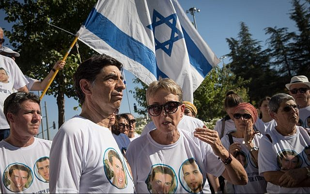 Leah Goldin, right, and her husband Simcha Goldin and other family members and supporters gather outside the state memorial ceremony for Operation Protective Edge at Mount Herzl on July 23, 2019. (Noam Revkin Fenton/Flash90)