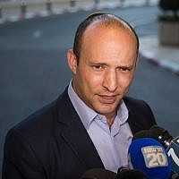 New Right party member Naftali Bennett arrives for a meeting with United Right party chairman Rafi Peretz, after announcing their union ahead of the elections, at the Ramada Hotel in Jerusalem, on July 28, 2019. (Yonatan Sindel/Flash90)