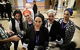 Women from the Ambash cult speak with reporters at the Knesset as they arrive to present their electoral slate to the Central Elections Committee on August 1, 2019. (Noam Revkin Fenton/Flash90)