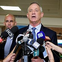 Blue and White leader Benny Gantz speaks to reporters at the Knesset as his party submits its electoral slate to the Central Elections Committee on August 1, 2019. (Flash90)