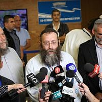 (From L-R) Benzi Gopstein, Baruch Marzel and Michael Ben-Ari from the Otzma Yehudit Party speak with the media outside the Central Elections Committee in Jerusalem, on August 1, 2019. (Noam Revkin Fenton/Flash90)