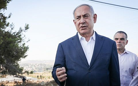 Prime Minister Benjamin Netanyahu at the scene where yeshiva student Dvir Sorek was killed in a West Bank terror attack, near the settlement of Migdal Oz in Gush Etzion, August 8, 2019. (Noam Revkin Fenton/Flash90)