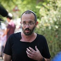 Yoav Sorek, father of Dvir Sorek who murdered in a terror attack, speaks with the media outside the family home in Ofra, in the West Bank on August 9, 2019. (Flash90)