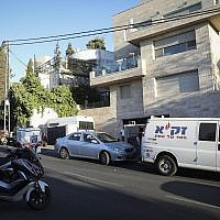 Medical and rescue workers at the Jerusalem home of a local government official, who was under investigations for corruption, was found dead in a suspected suicide on August 12, 2019. (Noam Revkin Fenton/Flash90)