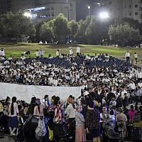 Ultra-Orthodox Jews at a concert featuring Haredi singer Motti Steinmetz, in a show where men and women in the audience sat separately, in the northern Israeli city of Afula on August 14, 2019. (Meir Vaknin/Flash90)
