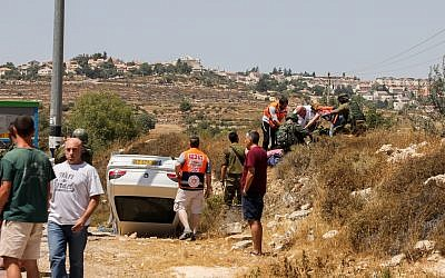 The scene of a suspected car-ramming attack outside Elazar in the West Bank on August 16, 2019 (Gershon Elinson/Flash90)