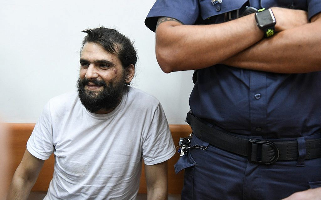 Telegrass founder Amos Dov Silver appears at the Rishon Lezion Magistrate's Court for a remand hearing on August 18, 2019, after being extradited to Israel from Ukraine. (Avi Dishi/Flash90)