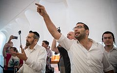 Right-wing activists shout at Joint (Arab) List lawmakers and candidates (unseen) as they arrive at a hearing at the High Court of Justice in Jerusalem on right-wing petitions to disqualify their parties from standing in the September 2019 election, on August 22, 2019. (Yonatan Sindel/Flash90)