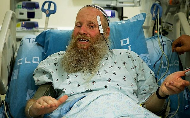 Rabbi Eitan Shnerb speaks to the media at the Hadassah Medical Center Ein Kerem, a day after being wounded in a terrorist bombing near Dolev that killed his daughter Rina and wounded his son Dvir, August 24, 2019. (Flash90)