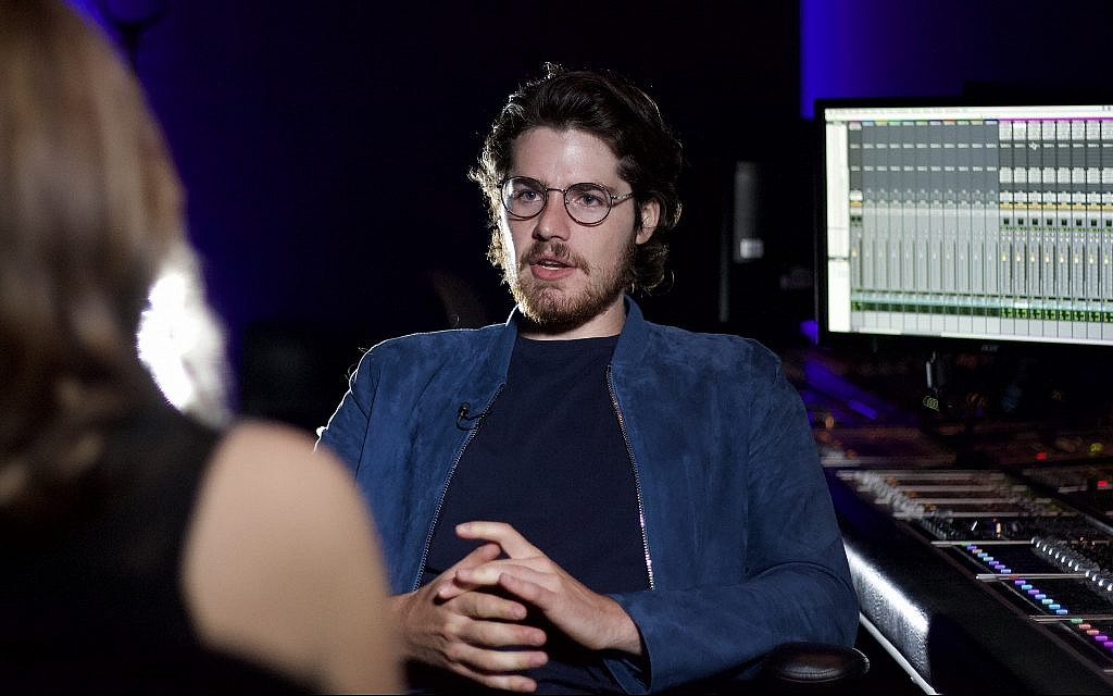 Film director Daniel Roher during a CBC TV interview at a digital post-production studio in Toronto, Ontario, August 29, 2019. (Etye Sarner)