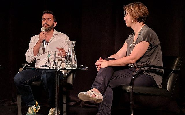 'Shababnikim' creator Eliran Malka is interviewed by Times of Israel culture writer Jessica Steinberg for a Times of Israel Presents event at Beit Avi Chai on August 25, 2019 (Courtesy Matthew Kalman)