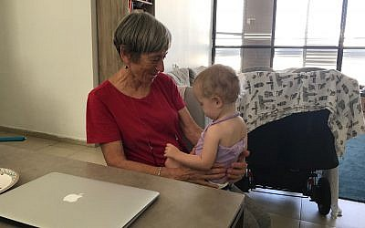 Prof. Mary Rudolf and her grandchild in Tel Aviv, July 30, 2019 (Shoshanna Solomon/Times of Israel)
