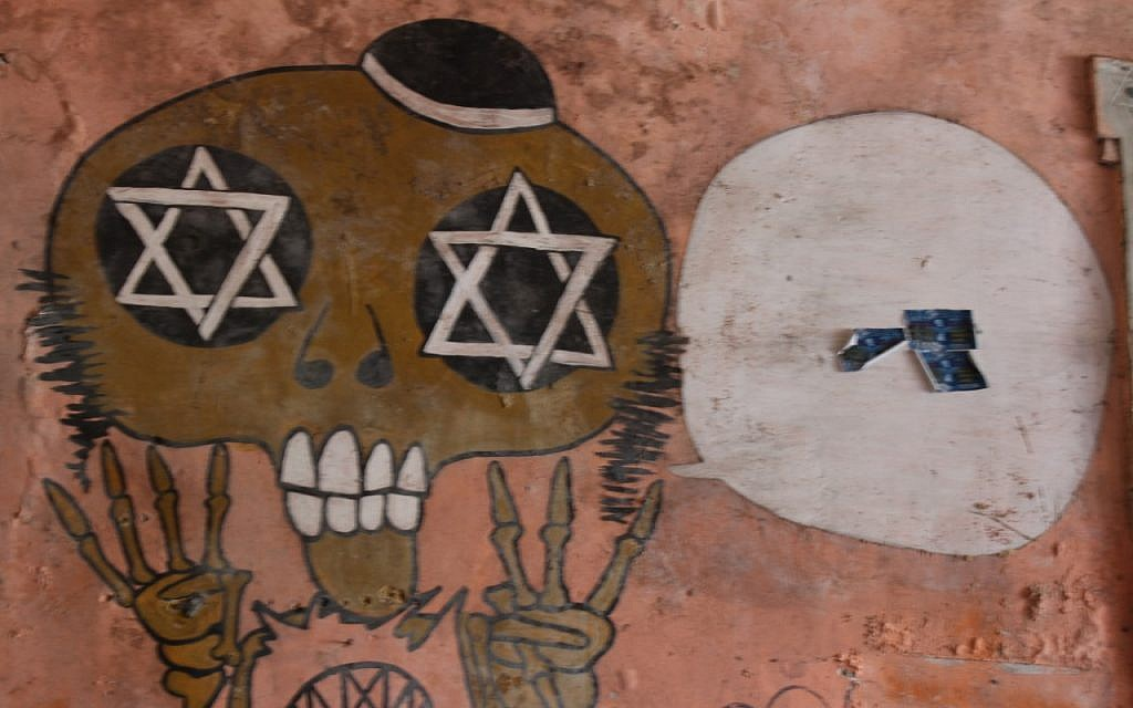 Anti-Semitic graffiti drawn onto the walls of the newly-reclaimed synagogue in Buenos Aires that for years had housed raves thrown by squatters. (Daniel Silicaro)