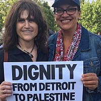 Rep Rashida Tlaib, D-Mich (right), attends a Shabbat gathering in a Detroit park on August 16, 2019, arranged by Jewish Voice For Peace Action to show the freshman congresswoman support, after a planned visit to Jerusalem and the West Bank by Tlaib and colleague Ilhan Omar was barred by Israel. (JVP, via JTA)