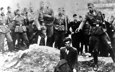 """A photograph known as """"The Last Jew in Vinnitsa"""" taken during the Holocaust in Ukraine showing a Jewish man near the town of Vinnitsa about to be shot dead by a member of the Nazis' Einsatzgruppe. (Public Domain)"""