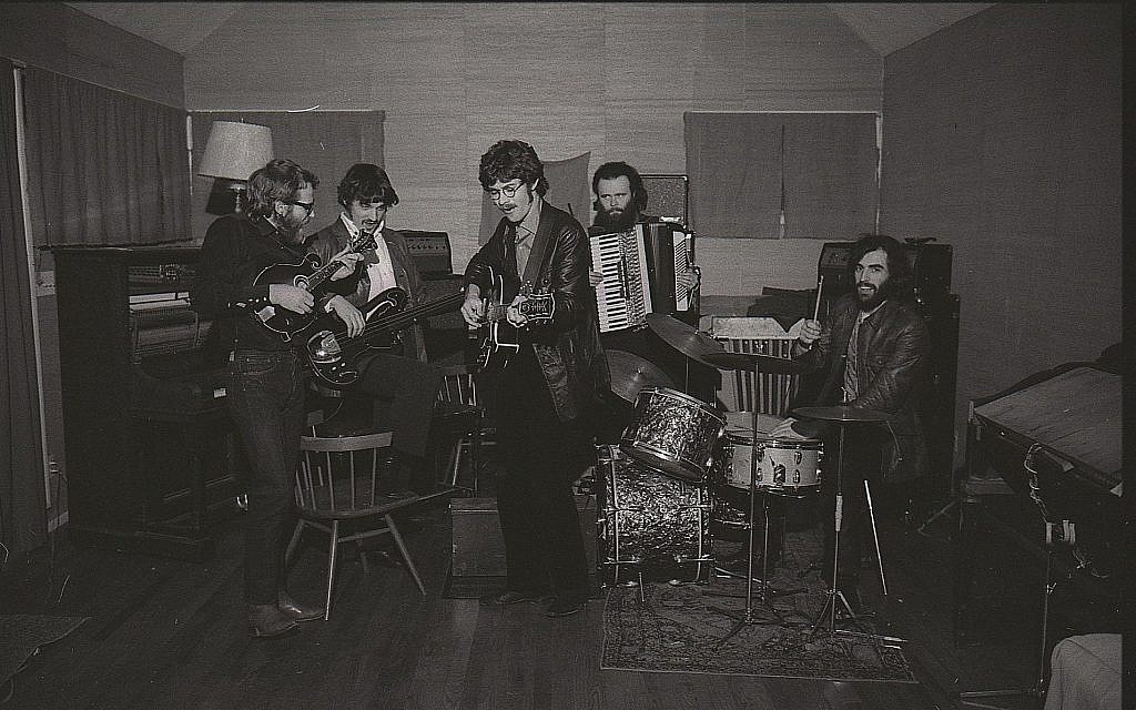 Robbie Robertson, center, with The Band. (David Gahr)