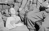 Fascist politician and Nazi propaganda broadcaster William Joyce, known as Lord Haw Haw, lies in an ambulance after his arrest by British officers at Flensburg, Germany, on May 29, 1945. He was shot in the leg during his arrest. (Public domain)