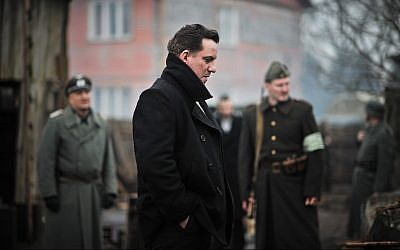 Latvian star Arturs Skrastins, left, portrays Latvian Holocaust hero and Righteous Among the Nations member Zanis Lipke in the new historical drama film 'The Mover.' (Courtesy Washington Jewish Film Festival)