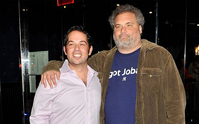 David Kimowitz, left, with comedian Artie Lange, attends the grand opening of The Stand comedy club in New York City, September 20, 2012. (Michael N. Todaro/Getty Images via JTA)