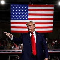 US President Donald Trump reacts at the end of a speech at a campaign rally, Aug. 15, 2019, in Manchester, New Hampshire. (AP Photo/Patrick Semansky)