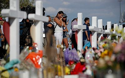 People visit a makeshift memoria at the site of a mass shooting in El Paso, Texas, August 5, 2019. (AP Photo/John Locher)