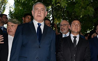 Prime Minister Benjamin Netanyahu, left, and Ukrainian President Volodymyr Zelensky, right, stand at Babi Yar ravine where Nazi troops murdered tens of thousands of Jews during WWII, in Kyiv, Ukraine, August 19, 2019. (AP Photo/Zoya Shu)
