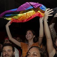 A girl waves a rainbow flag during a concert organized in solidarity with Lebanese indie band Mashrou' Leila in Lebanon's capital Beirut, August 9, 2019. (Anwar Amro/AFP)