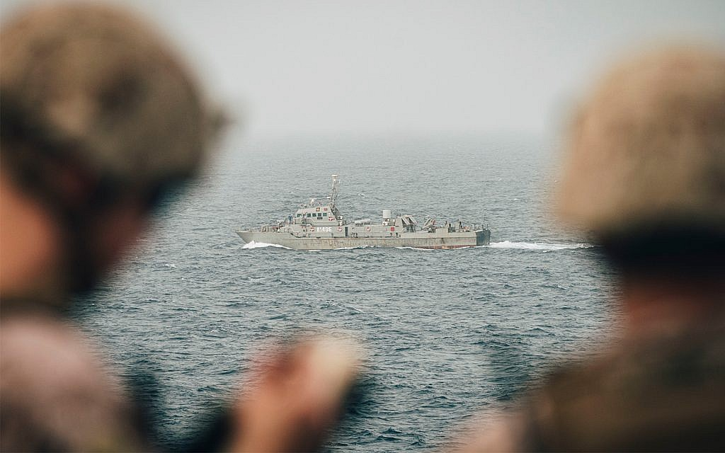 US Marines monitor an Iranian navy vessel from the USS John P. Murtha in the Strait of Hormuz, August 12, 2019. (US Marine Corps photo by Staff Sgt. Donald Holbert/Released)
