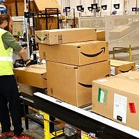 An Amazon fulfillment center processes orders in Aurora, Colorado, May 3, 2018. (AP Photo/David Zalubowski)