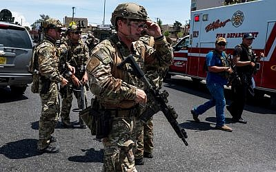 Law enforcement agencies respond to an active shooter at a WalMart near Cielo Vista Mall in El Paso, Texas, August 3, 2019. (Joel Angel Juarez/AFP)