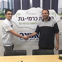 Israeli chess prodigy Yair Hoffman, left, and sponsor Israel Zeira. (Courtesy of Be'Emunah via JTA)