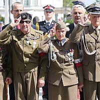 Polish officials and war veterans pay tribute to a World War II-era underground force that collaborated with Nazi German forces toward the end of the war in Warsaw, Poland, August 11, 2019. (AP Photo/Czarek Sokolowski)