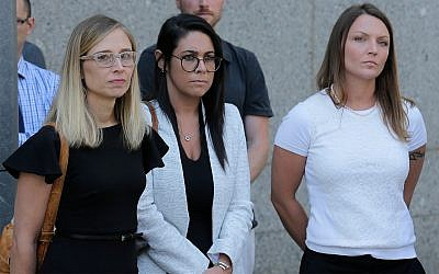 Annie Farmer, left, and Courtney Wild, right, alleged victims of Jeffery Epstein, in New York, July 15, 2019. (AP Photo/Seth Wenig)