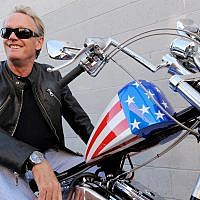 In this Friday, Oct. 23, 2009 file photo, Peter Fonda poses atop a Harley-Davidson motorcycle in Glendale, Calif. (AP Photo/Chris Pizzello, File)