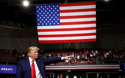 US President Donald Trump reacts at the end of his speech at a campaign rally, August 15, 2019, in Manchester, New Hampshire. (AP Photo/Patrick Semansky)