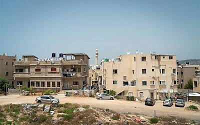 Illustrative: homes in the northern town of Jisr az-Zarka, May 26, 2018. (Luke Tress/Times of Israel)