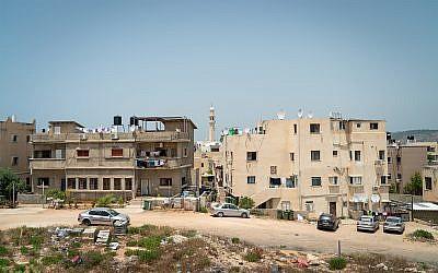 Illustrative: homes in the northern town of Jisr az-Zarka, May 26, 2018. (Luke Tress/Times of Israel)