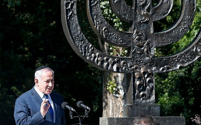 Prime Minister Benjamin Netanyahu speaks at the Babi Yar ravine, where Nazi troops murdered thousands of Jews during WWII, in Kyiv, Ukraine, August 19, 2019. (AP Photo/Efrem Lukatsky)