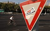 A man rides his bicycle near a poster demanding the release of Yigal Amir, the assassin of prime minister Yitzhak Rabin, in Jerusalem, November 2, 2006. (YOSSI ZAMIR/FLASH 90)