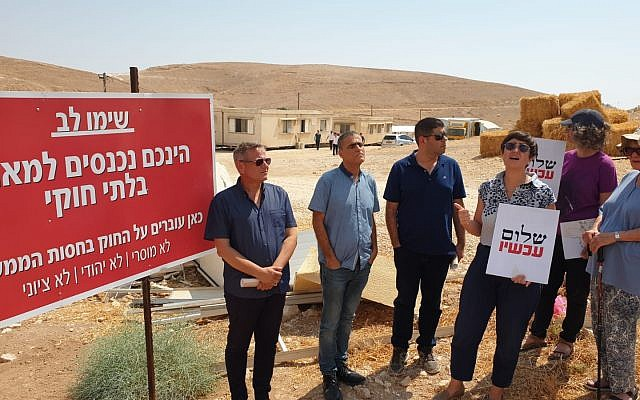 (From L-R) Democratic Camp chairman Nitzan Horwitz, former Meretz MK Mossi Raz, former Peace Now executive director Yariv Oppenheimer and current director Shaqued Morag stand outside an illegal outpost in the central West Bank on July 22, 2019. (Peace Now)
