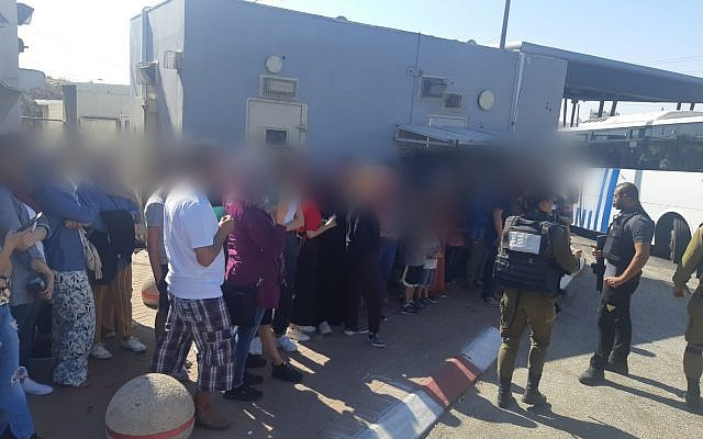 Palestinians are detained at a Jerusalem area crossing after attempting to illegally enter Israel to go to the beach on August 15, 2019 (Israel Police)