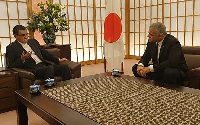 Japanese FM Taro Kono, left, hosts MK Yair Lapid in Tokyo, August 19, 2019 (Courtesy)