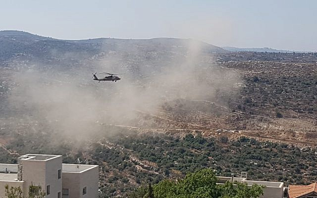 An Israeli military helicopter picks up two victims of a terror attack in the central West Bank on August 23, 2019. (Dolev settlement)