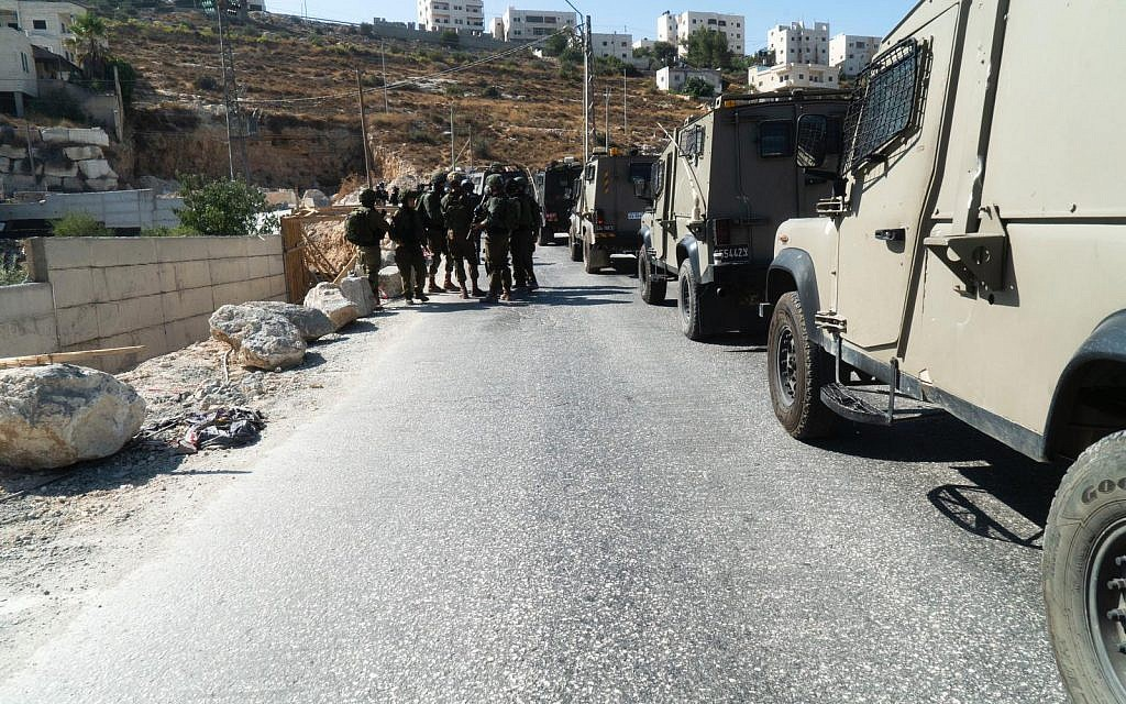 Illustrative: IDF troops conduct search operations around the Palestinian village of Beit Fajjar, near Bethlehem, in the West Bank after the body of a soldier with stab wounds was found near the Gush Etzion settlement on August 8, 2019. (Israel Defense Forces)