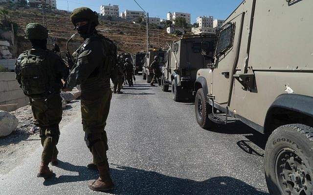 IDF troops conduct search operations around the Palestinian village of Beit Fajjar, near Bethlehem, in the West Bank after the body of a soldier with stab wounds was found near the Gush Etzion settlement on August 8, 2019. (Israel Defense Forces)