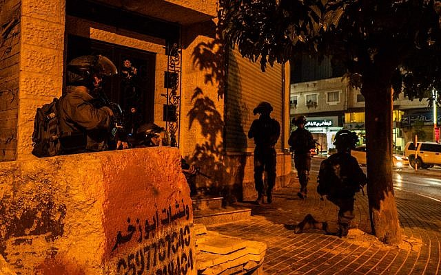 In a picture released by the Israel Defense Forces on August 10, 2019, Israel soldiers search in the West Bank for the terrorists who killed yeshiva student Dvir Sorek. (Israel Defense Forces)