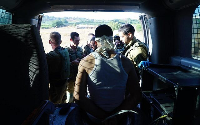 One of the suspects in the murder of Dvir Sorek after being arrested by the IDF in the West Bank on August 10, 2019. (Israel Defense Forces)